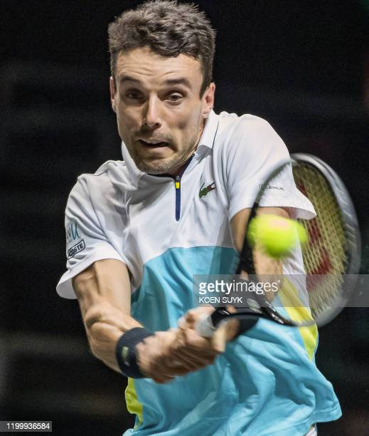 Spain's Roberto Bautista Agut return's the ball to Hungary's Marton Fucsovics during his match against France's Adrian Mannarino in the first round...