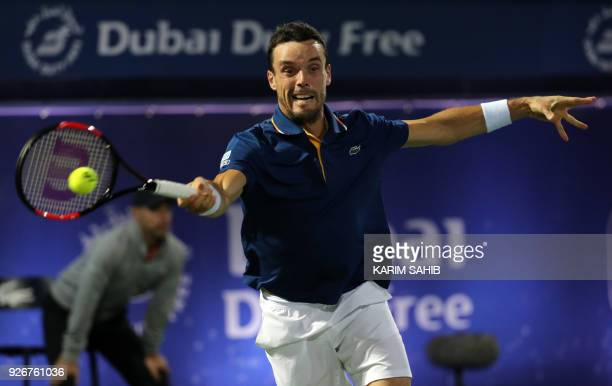 Spain's Roberto Bautista Agut returns the ball to Lucas Pouille of France during their final match in the 2018 ATP Dubai Duty Free Tennis...