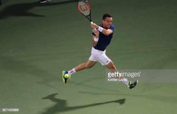 Spain's Roberto Bautista Agut returns the ball to Malek Jaziri of Tunisia during their semifinal match in the 2018 ATP Dubai Duty Free Tennis...