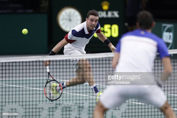 Spain's Roberto Bautista Agut runs for the ball as he plays against Croatia's Marin Cilic during the 1/8 round at the ATP World Tour Masters 1000...