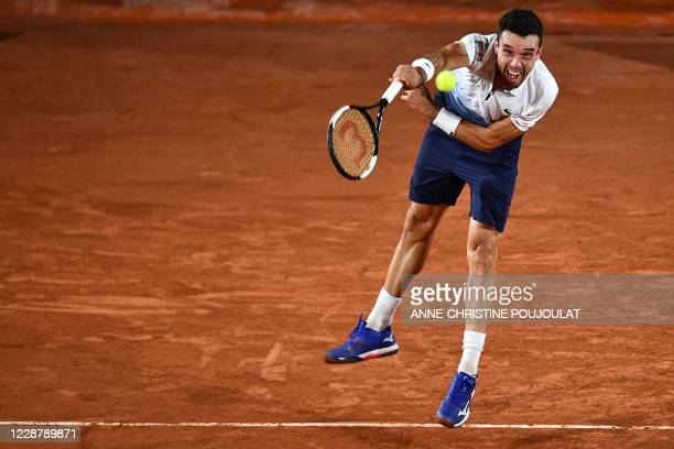 Spain's Roberto Bautista Agut serves the ball to France's Richard Gasquet during their men's singles first round tennis match at the Simonne Mathieu...
