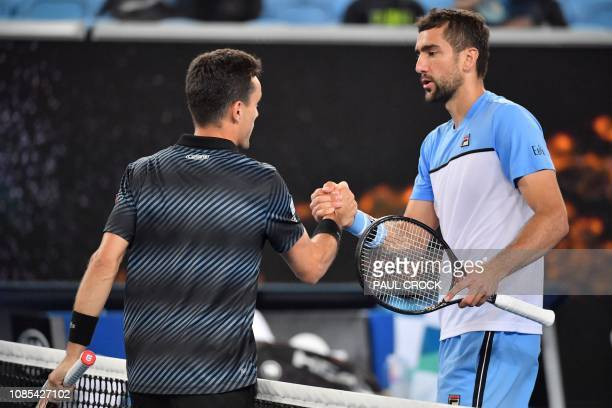 Spain's Roberto Bautista Agut shakes hands with Croatia's Marin Cilic after their men's singles match on day seven of the Australian Open tennis...