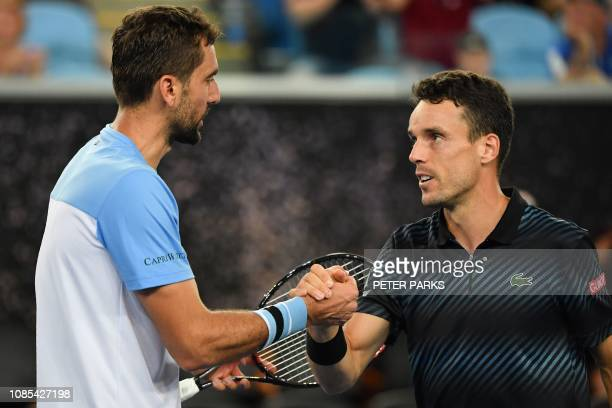 Spain's Roberto Bautista Agut shakes hands with Croatia's Marin Cilic after winning their men's singles match on day seven of the Australian Open...