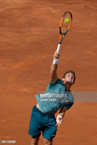 Spain's Roberto Carballes Baena serves to Spain's Rafael Nadal during their Barcelona Open ATP tournament tennis match in Barcelona on April 25 2018