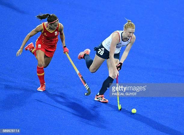 Spain's Rocio Ybarra vies with Britain's Nicola White during the women's quarterfinal field hockey Britain vs Spain match of the Rio 2016 Olympics...