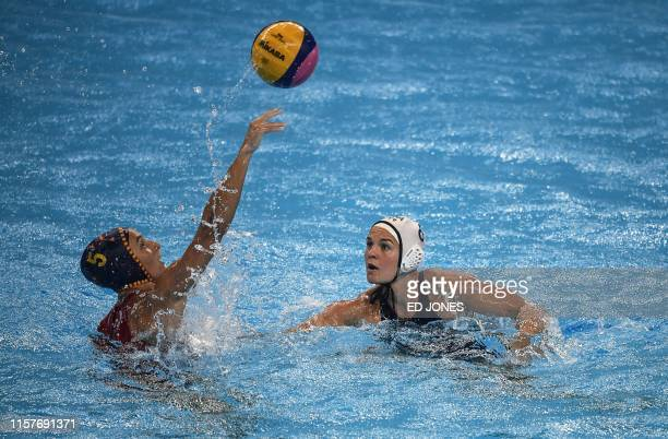 Spain's Roser Tarrago Aymerich vies for the ball with USA's Kiley Neushul during the women's final match between USA and Spain of the water polo...
