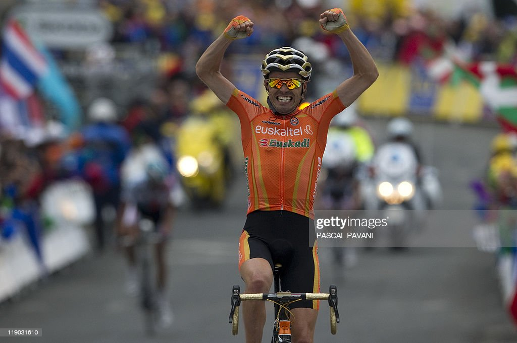 Spain's Samuel Sanchez celebrates as he wins the 211 km and twelfth stage of the 2011 Tour de France cycling race run between Cugnaux and the 2.500 metres ski resort of Luz-Ardiden, southwestern France, on July 14 , 2011.