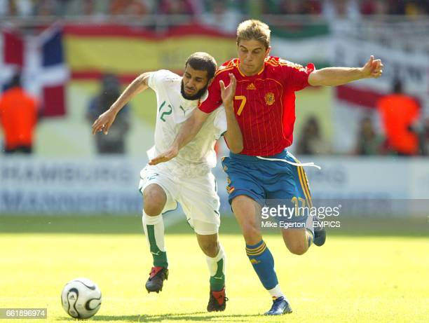 Spain's Sanchez Joaquin and Saudi Arabia's Abdulaziz Khathran battle for the ball