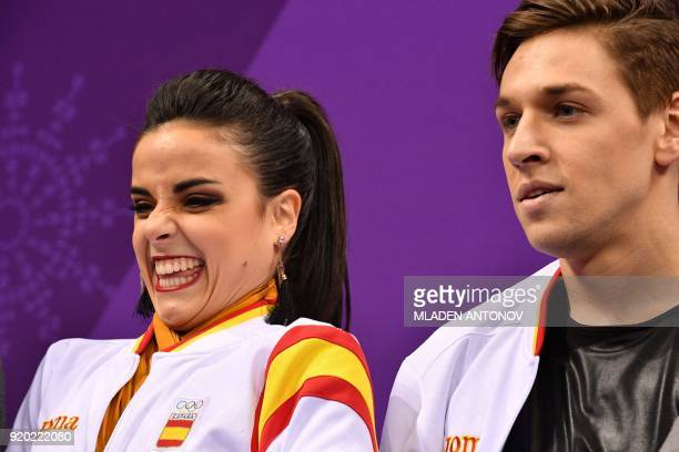 TOPSHOT Spain's Sara Hurtado and Spain's Kirill Khaliavin react after competing in the ice dance short dance of the figure skating event during the...
