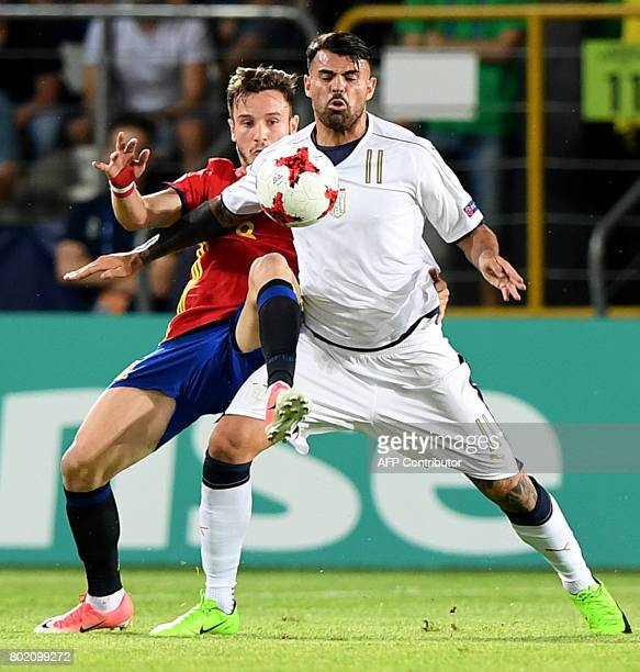 Spain's Saul Niguez and Italy's Andrea Petagna vie for the ball during the UEFA U21 European Championship football semi final match Spain v Italy in...