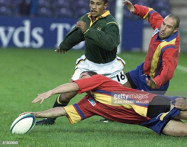 Spain's scrumhalf Aratz Gallastegui dives to grab the ball in front of South African centre Deon Kayser and Spain's fullback Francisco Puertas and...