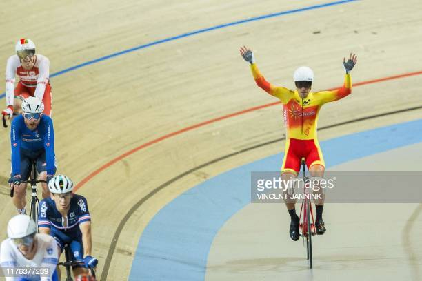 Spain's Sebastian Mora Vedri celebrates after winning the men's scratch final at the European Track Cycling Championship in Apeldoorn on October 17...
