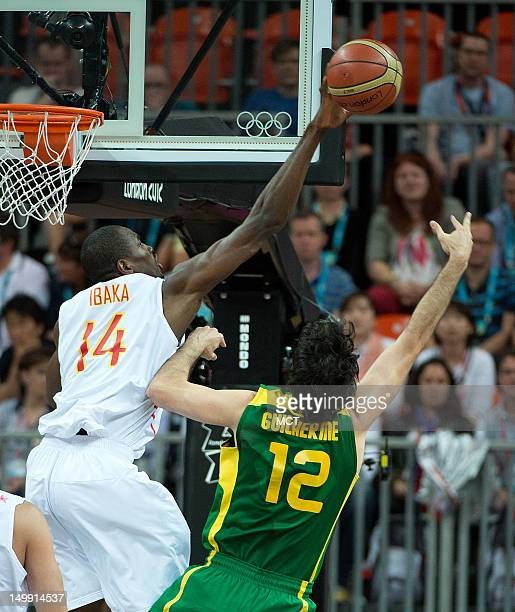 Spain's Serge Ibaka blocks the shot of Brazil's Guilherme Giovannoni during their game at the Olympic Park Basketball Arena during the 2012 Summer...