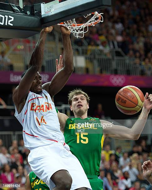 Spain's Serge Ibaka slam dunks over Brazil's Tiago Splitter during their game at the Olympic Park Basketball Arena during the 2012 Summer Olympic...