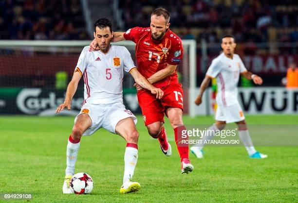 Spain's Sergio Busquets vies with Macedonia's Ostoja Stjepanovic during the FIFA World Cup 2018 qualification football match between Macedonia and...