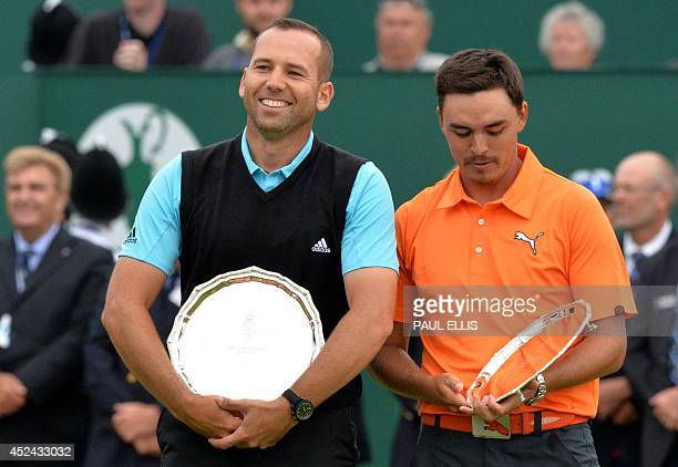 Spain's Sergio Garcia and US golfer Rickie Fowler stand with their second place trophies after finishing two strokes behind winner Northern Ireland's...