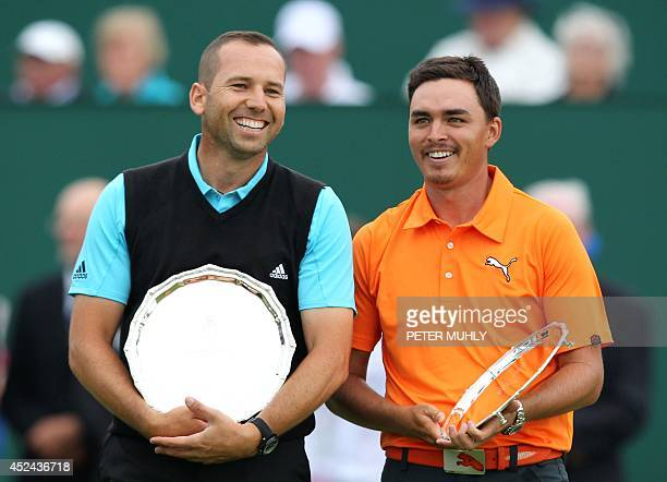 Spain's Sergio Garcia and US golfer Rickie Fowler stand with their second place trophies after finishing two strokes behind winner, Northern...