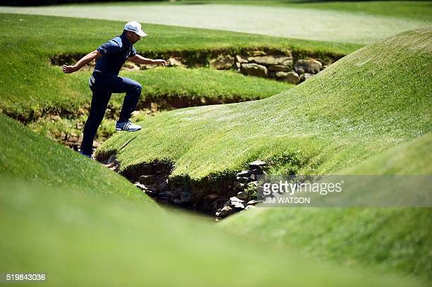 Spain's Sergio Garcia crosses over a creek during Round 2 of the 80th Masters Golf Tournament at the Augusta National Golf Club on April 8 in Augusta...