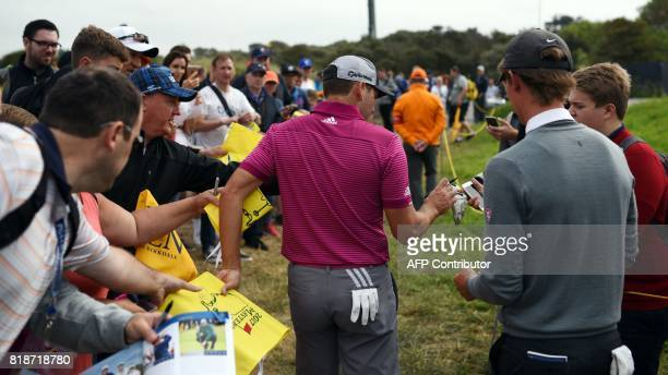Spain's Sergio Garcia signs autographs for fans during a practice round at Royal Birkdale golf course near Southport in north west England on July 19...