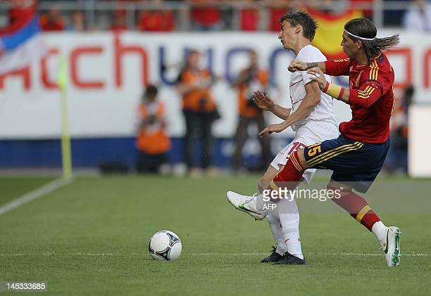 Spain's Sergio Ramos fights for the ball with Serbia's Filip Duricic during the friendly football match between Spain and Serbia at the AFG Arena in...