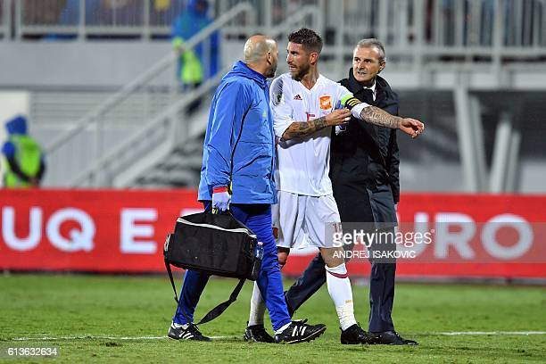 Spain's Sergio Ramos leaves the pitch after injury during the FIFA World Cup 2018 qualification football match Albania vs Spain at the LoroBorici...