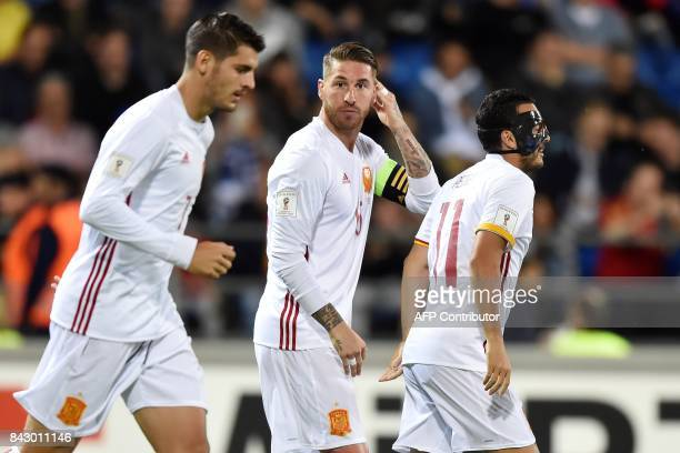 Spain's Sergio Ramos reacts next to his teammates Alvaro Morata and Pedro Rodriguez after scoring a goal during the FIFA World Cup 2018 qualification...