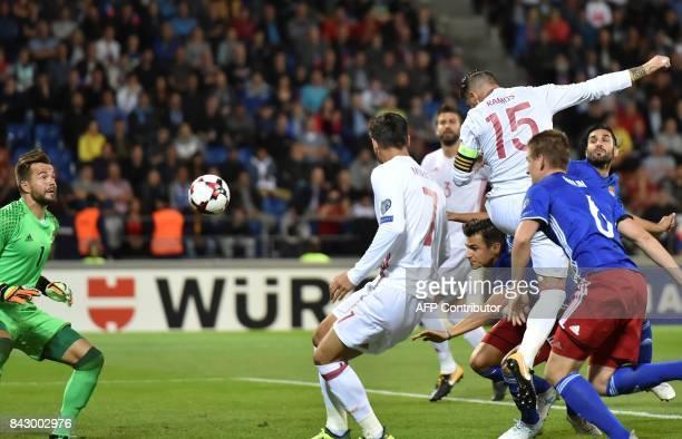 Spain's Sergio Ramos scores a goal despite Liechtenstein's goalkeeper Peter Jehle during the FIFA World Cup 2018 qualification football match between...