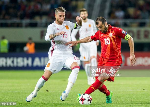Spain's Sergio Ramos tackles Macedonia's Goran Pandev during the FIFA World Cup 2018 qualifying football match between Macedonia and Spain at Philip...