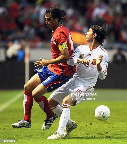 Spain's Sergio Ramos vies for the ball with Brian Ruiz of Costa Rica during a friendly match at the National Stadium in San Jose on November 15 2011...