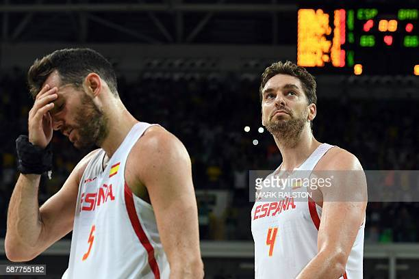 TOPSHOT Spain's small forward Rudy Fernandez and Spain's centre Pau Gasol leave the court after Brazil defeated Spain during a Men's round Group B...