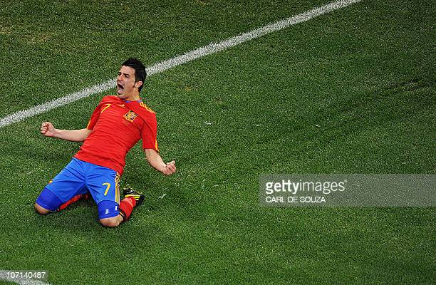Spain's striker David Villa celebrates after scoring against Portugal during the 2010 World Cup round of 16 match between Spain and Portugal on June...