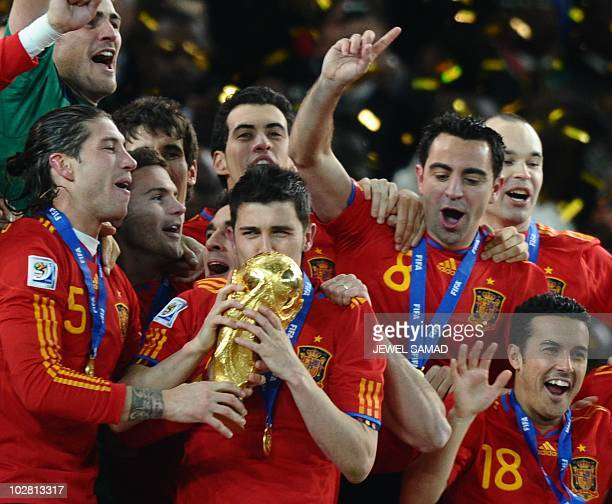 Spain's striker David Villa kisses the trophy as Spain's national football team players celebrate winning the 2010 World Cup football final...