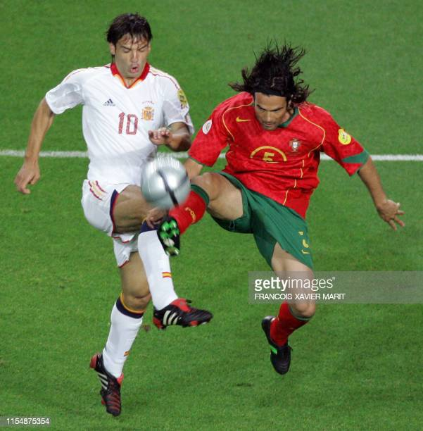 Spain's striker Fernando Morientes vies with Portugal's defender Fernando Couto 20 June 2004 at Jose Alvalade stadium in Lisbon during their Euro...