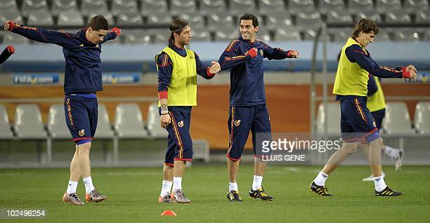Spain's striker Fernando Torres defender Sergio Ramos defender Alvaro Arbeloa and midfielder Xabi Alonso take part in a official training session at...