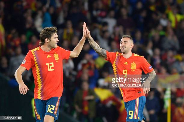 Spain's striker Paco Alcacer celebrates with Spain's defender Marcos Alonso after scoring a goal during the UEFA Nations League football match...