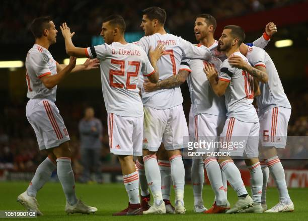 Spain's striker Paco Alcacer is mobbed by teammates after scoring the opening goal during the international friendly football match between Wales and...