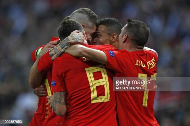 Spain's striker Rodrigo celebrates with teammates after scoring their second goal during the UEFA Nations League football match between England and...