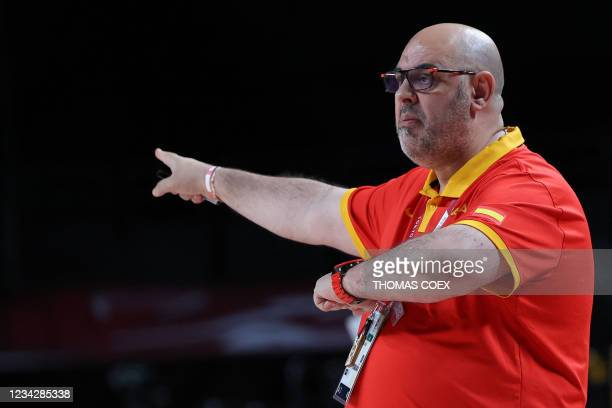 Spain's team coach Lucas Mondelo gestures to his players in the women's preliminary round group A basketball match between Spain and Serbia during...