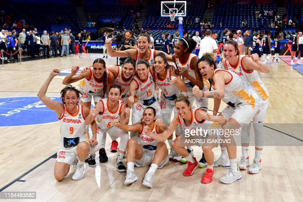 Spain's team players pose for pictures as they celebrate after winning the Women's Eurobasket 2019 final basketball match between Spain and France on...