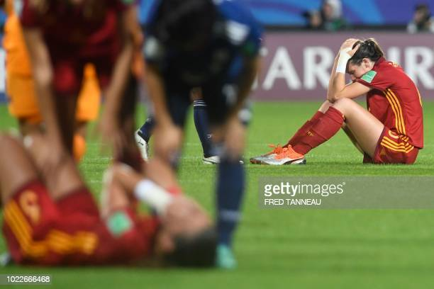 Spain's team players react at the end of the Women's U20 World Cup final football match between Spain and Japan on August 24 at the La Rabine Stadium...