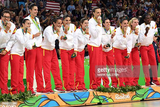 Spain's team pose with their silver medals after the final of the Women's basketball competition at the Carioca Arena 1 in Rio de Janeiro on August...