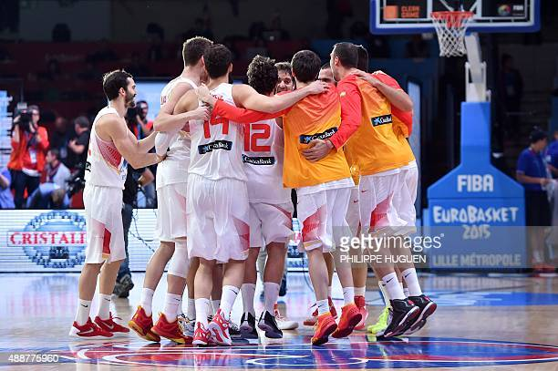 Spain's teammates celebrate after defeating France in the semifinal basketball match between Spain and France at the EuroBasket 2015 in Lille...