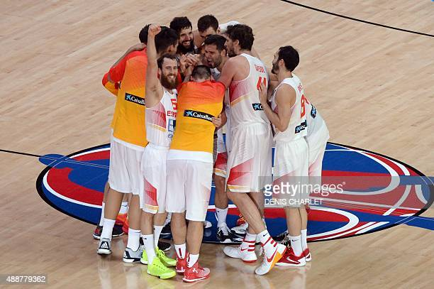 Spain's teammates celebrate after Spain defeated France in the semifinal basketball match between Spain and France at the EuroBasket 2015 in Lille...