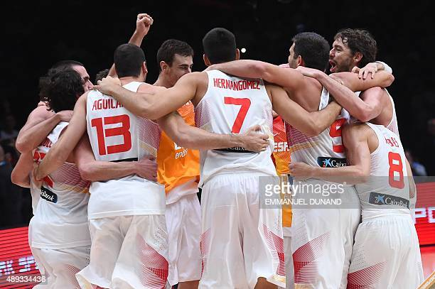 Spain's teammates celebrate after Spain won the final ba sketball match between Spain and Lithuania at the EuroBasket 2015 in Lille northern France...
