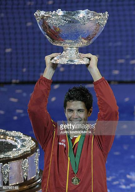 Spain's tennis player Fernando Verdasco holds up the trophy after defeating Argentina's tennis player Jose Acasuso in the Davis Cup 2008 World Group...