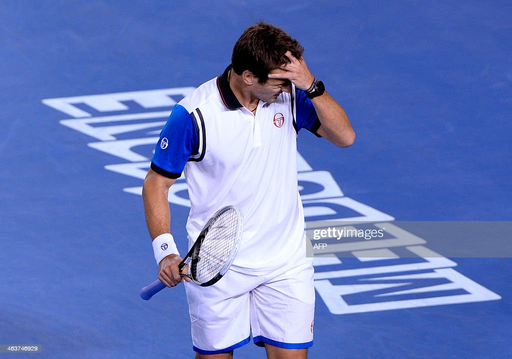 Spain's Tommy Robredo reacts during his men's singles match against Switzerland's Stanislas Wawrinka on day seven of the 2014 Australian Open tennis tournament in Melbourne on January 19, 2014. IMAGE