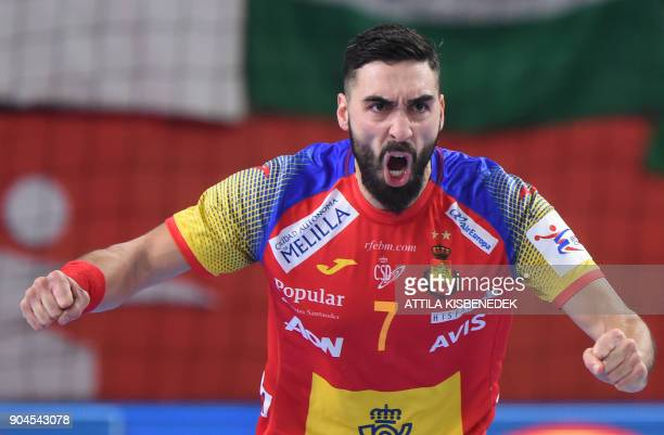 Spain's Valero Rivera Folch celebrates his score against Czech Republic during their match in the 13th edition of the EHF European Men's Handball...