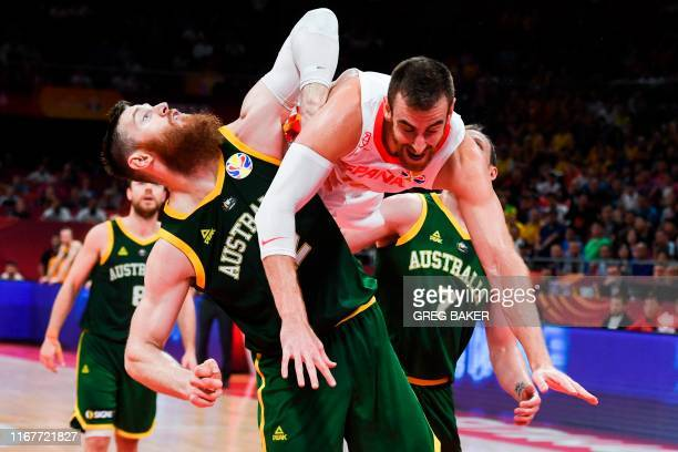 TOPSHOT Spain's Victor Claver fights for the ball with Australia's Aron Baynes and Joe Ingles during the Basketball World Cup semifinal game between...