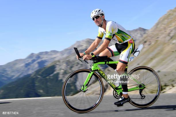 Spain's Victor Del Corral Morales rides through the Col d'Izoard mountain pass during the cycling portion of the 34th edition of the Ironman...