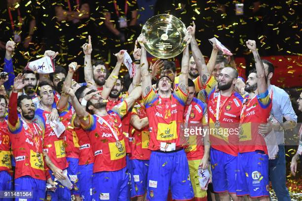 Spain's Viran Morros de Argila holds the EHF European Handball Championship trophy as Spain's players celebrate during the podium ceremony after...